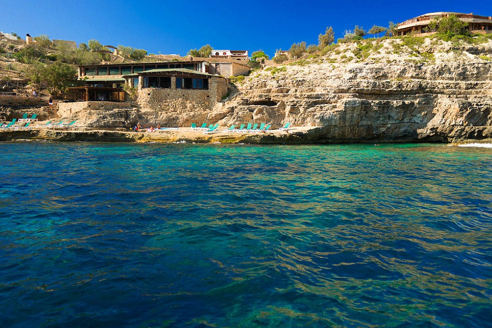 The Relais' Beach Bar, beach and Restaurant seen from the sea